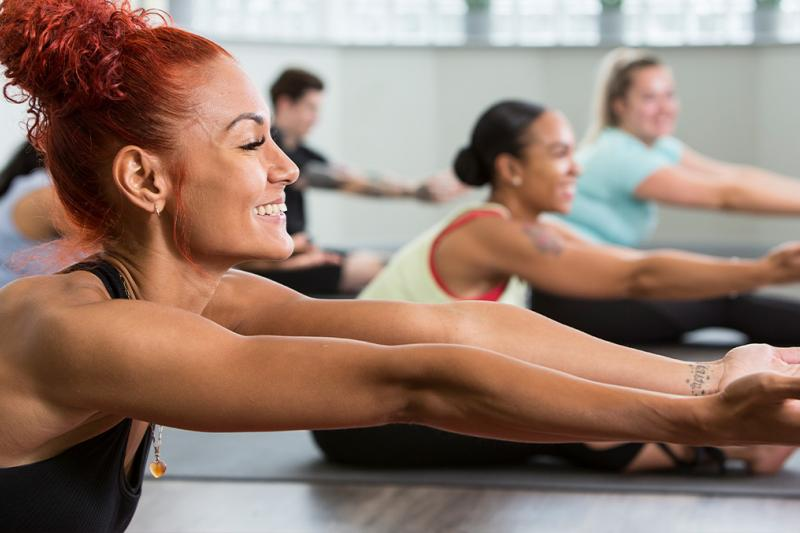 Woman enjoying a yoga class