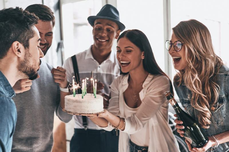 People enjoying a birthday party
