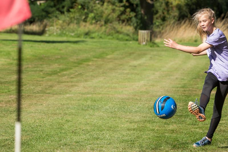 Girl playing FootGolf