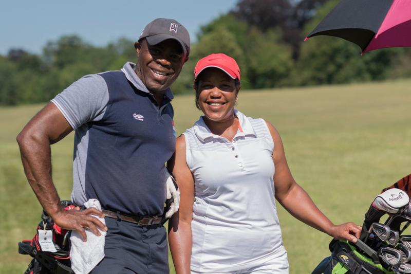 A couple out enjoying golf on the golf course