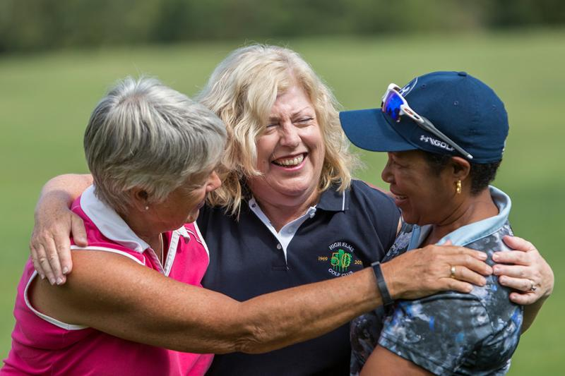 Three ladies enjoying playing golf