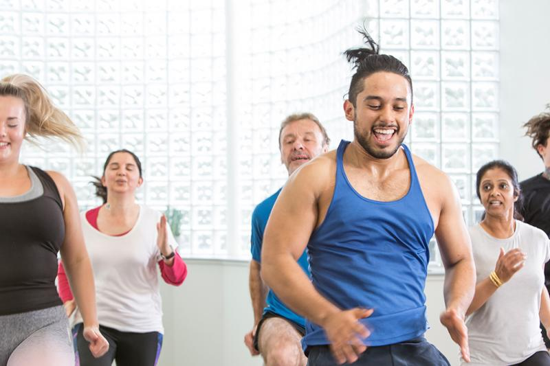 People smiling in a group exercise class