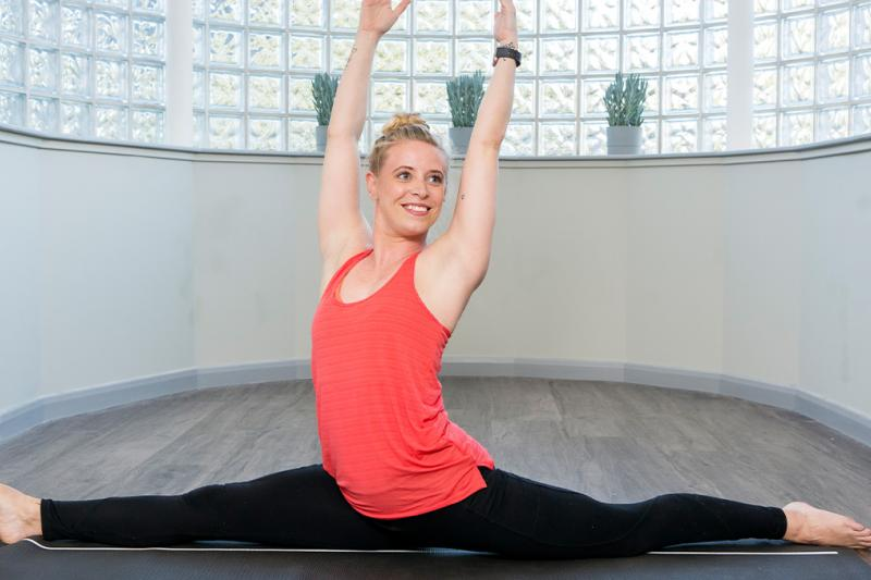 A lady stretching in a yoga class