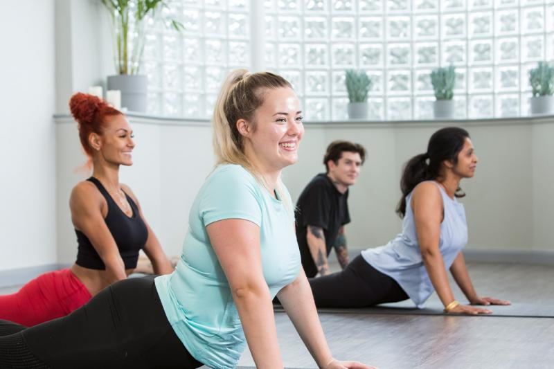 Group smiling at a yoga class