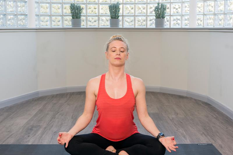 Lady in seated yoga pose