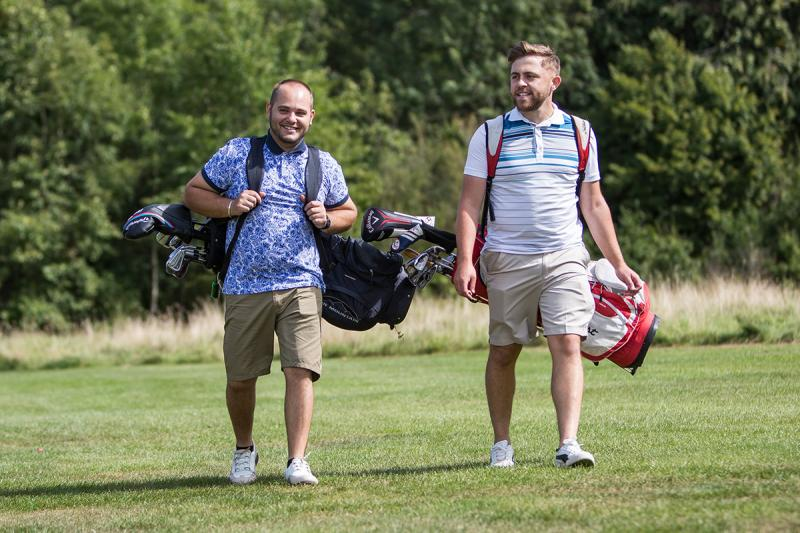 Two men playing golf